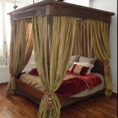 Indonesian teak four poster bed. Would use different fabric colors but love the concept