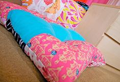 floor cushion...Not these colors but if I could sew I would use all her blog ideas! amazing blog