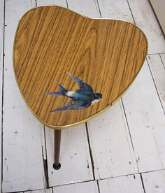 """The cutest 1950s coffee table in a very unusual heart shape. I have updated it with a decoupaged vintage swallow. 14"""" wide and 17"""" high."""