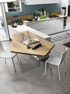 STOSA: Rewind: work surface and design detail for the pentagonal table with . Kitchen Island Table, Kitchen Dinning, Home Decor Kitchen, Kitchen Furniture, New Kitchen, Home Kitchens, Kitchen Cabinets, Modern Kitchen Design, Interior Design Kitchen
