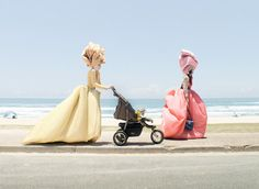 Outdoor... by Aussie photographer Georges Antoni (note Aussie tote carried by model in red dress right) Love the juxtaposition of !8thC inspired clothing, the 21stC stroller and the outdoor landscape of beach (not your usual setting for 18thC clothing) Fabulous!