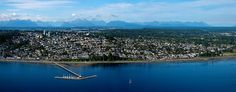 Gorgeous Aerial Photo - OCEAN VIEWS an up close aerial panorama of White Rock with The Pier, and many of the houses up to ave. Sailboat in the foreground and the coast mountains in the background. City By The Sea, Aerial Photography, Aerial View, Sailboat, Vancouver, Tourism, Coast, Ocean Views, Mountains