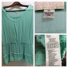 Aqua top with nice details Aqua top with linen feel and cute lace details. Forever 21 Tops