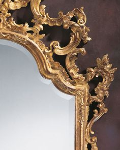 18th century Italian style carved wood wall mirror in antiqued gold leaf finish