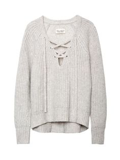 All of the oversize knitwear that can hide your holiday sins!  Nili Lotan Lace-Up V-Neck Sweater, $875; nililotan.com