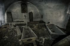 Poland-coffin church is year old church. The crypt was full of coffins, all empty as during the Soviet occupancy the bodies had been robbed of anything worth any money Haunted Places, Abandoned Places, Haunted Houses, Banners, Tales From The Crypt, Old Churches, Sign Printing, Casket, Macabre