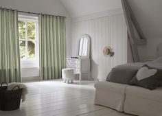 Add a light filtering layer of privacy to the bedroom with unlined grommet drapery panels. #BudgetBlinds