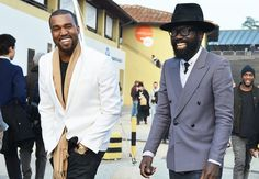 This blazer combination on Kanye West is so luxurious and refined- the white blazer and beige scarf look great with a simple black t-shirt, dark denim jeans, and seemingly basic watch and gold bracelet details.