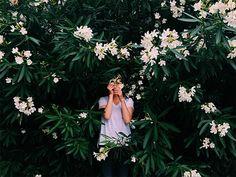 flower clad portrait by SAINT LUCY Represents photographer Anastasiia Sapon