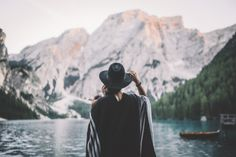 the mountains are calling by johannesnollmeyer  lake girl beauty mountains boat nature travel blue hat lifestyle peak dolomites beauty in nature adv