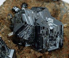 Close-up view of a portion of a cassiterite specimen, main crystal 4 cm, Panasqueira mines, Panasqueira, Covilhã, Castelo Branco district, Portugal.
