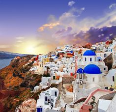 Santorini is an island remaining after a volcanic eruption with a unique landscape of steep cliffs surrounding the beautiful blue waters of a lagoon that connects to the sea.