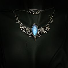 AMANANTIUX - silver and moonstone. by LUNARIEEN elf queen princess jewelry necklace gemstone gem cosplay costume LARP LRP equipment gear magic item | Create your own roleplaying game material w/ RPG Bard: www.rpgbard.com | Writing inspiration for Dungeons and Dragons DND D&D Pathfinder PFRPG Warhammer 40k Star Wars Shadowrun Call of Cthulhu Lord of the Rings LoTR + d20 fantasy science fiction scifi horror design | Not Trusty Sword art: click artwork for source