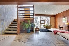 mosaic-shuffleboard-floor and open stairs in mid-century 1955 house. The open stairs make this look so airy.