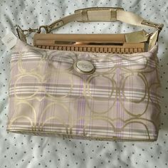 """Coach Signature Plaid Hobo Cream colored hobo with lavender, plum, and gold accent prints. Interior features lavender satin lining with zipper pocket on one side and open pockets on the opposite. Got this as a gift and nevered used it. Tag is still attached (with price portion detached) and in new condition. Measures about 13"""" in length and 10"""" in height at full capacity. Coach Bags Hobos"""