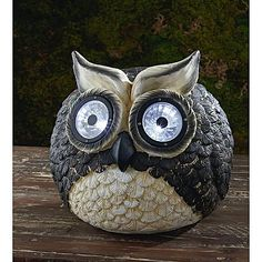 My nephews would die if we had an owl like this in our backyard (with solar-powered lights).