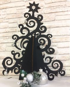 This black Christmas tree, is a black tree art, creates a new atmosphere, an alternative Christmas! Artistic tree, eco friendly, black Christmas tree, recycled cardboard, alternative Christmas decoration, Christmas ornaments, home decoration, measuring 19 x 27 inc. is laser cut. For respect for nature choose sustainable decorations, eco friendly. The forests will thank you! PAY ATTENTION TO THE SHIPPING, at Christmas time I can not guarantee on-time postal service. Amaze your guests with...