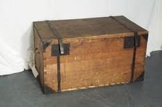 using an antique trunk for a coffee table or end table.