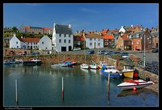 Scotland. The classic Crail view with red-tiled, whitewash houses and its busy harbour.