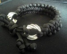 Paracord bracelet with metal rings by CordChaos on Etsy
