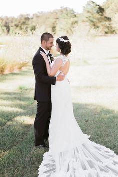 Classic black tie wedding with an all lace Stella York wedding dress