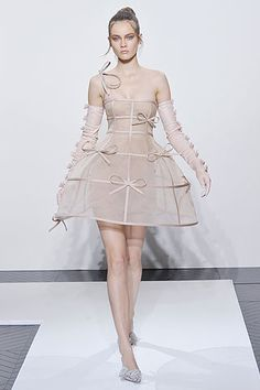 Pink crinoline inspired dress was created by Valentino during the Fall/Winter 2010-2011 Haute Couture Collection Show.