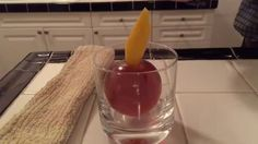 A cocktail INSIDE of an ice ball