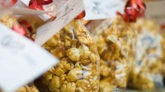 Popcorn is coated with brown sugar and corn syrup caramel then baked for a crunchy treat.
