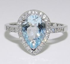 Pear Shaped Engagement Ring (desired with a blue diamond in a platinum setting).  Unlikely to be $599 Etsy price
