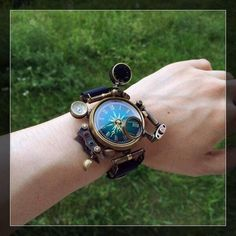 IDEA: This, but with a compass instead of a watch. The same substitution would work on any other accessible steampunk jewelery, especially lockets (or just hidden under some sort of disguised cover Moda Steampunk, Design Steampunk, Costume Steampunk, Style Steampunk, Steampunk Watch, Steampunk Clothing, Steampunk Fashion, Fashion Goth, Steampunk Makeup