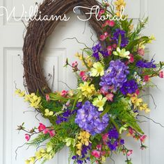 Spring and Summer Oval Grapevine Wreath by WilliamsFloral on Etsy https://www.etsy.com/listing/227434961/spring-and-summer-oval-grapevine-wreath