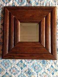 oak 3 rib 16 x 16 PV: This handmade mirror is crafted from oak molding salvaged from a late 1800's farm house in Clinton County Michigan. The molding had been removed from the house and after sitting in a barn on the farmstead for over 60 years, I rescued and restored each piece. Once the trim was restored it was shaped into the frame that you see in the picture. I then had a local mirror shop in Michigan cut a beveled glass mirror to put into each frame to give it the look of an old school…