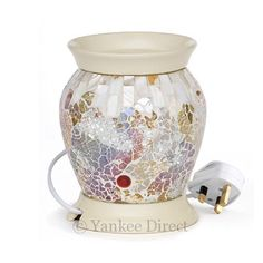 Designed exclusively for Yankee Candle®, this glazed, Gold and Pearl Mosaic Design electric warmer is the perfect way to enjoy the exceptional fragrancing of our Tarts® wax melts throughout the year. Description from yankeedirect.com. I searched for this on bing.com/images