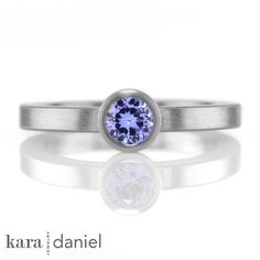 tanzanite stack ring | a brillant violet tanzanite is bezel-set in a classic stainless stack ring | #stackring #karadanieljewelry