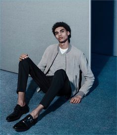 Playing it casual, Sol Goss wears a Lot 78 x Barneys New York suede bomber jacket, Maison Margiela sweater, Valentino trousers, and Crockett & Jones dress shoes.