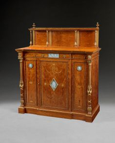 The ultimate in Neo-Classical, this superb Satinwood Cabinet was made by Wright and Mansfield in 1867 and is the companion piece to the cabinet by them now in the V&A and made for the Paris Exposition which won the Gold Medal. The plaques are all Wedgwood.