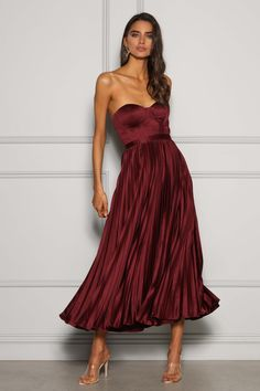 This stunning midi dress features a fully boned bustier bodice and fluid pleated skirt. Fitted to waist Slim fit Boned Built-in moulded cups at bust Fully Lined Concealed back zip < Dress Rental, Strapless Dress Formal, Formal Dresses, Poses For Photos, Pleated Midi Skirt, Milan, Bodice, Dress Up, Feminine