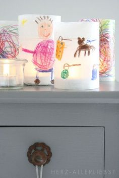Kids art luminaries. Kids colour parchment paper, wrap around glass candle holders. Could make any size.