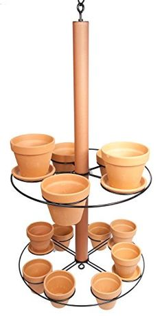 Hanging Planter ~ Holds five 6 inch and eight 4 inch pots... https://www.amazon.com/dp/B00ZGREINM/ref=cm_sw_r_pi_dp_a7QNxbGJA7H4J