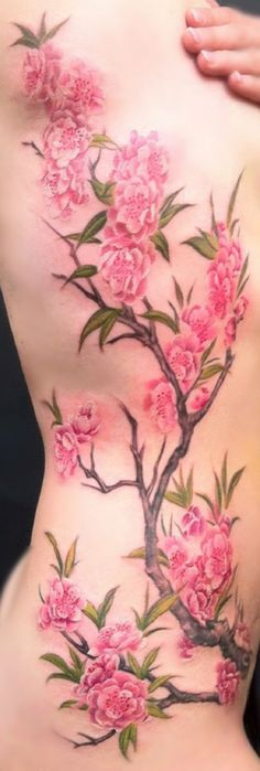 A really softly inked cherry blossom tattoo. You can almost feel the softness of the petals with how mild and innocent the design is created. Truly beautiful and captures the essence of the cherry blossoms.