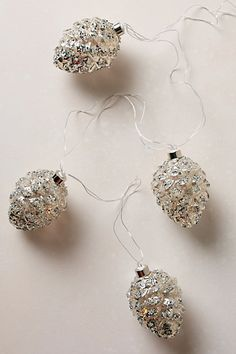 Glittered Pinecone String Lights - anthropologie.com #anthroregistry