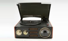 Empire turntable has cloth woven speakers, and retro brass dials at heart of this turntable
