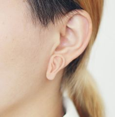 Flesh-colored body parts jewelry...because two ears just aren't enough.