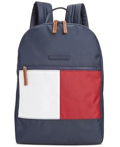 A throwback colorblock flag takes this flexible nylon backpack from Tommy Hilfiger in a sporty-chic direction reminiscent of the late '90s. Inside, a padded compartment fits most laptops, while a smal
