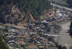 Damaged houses are seen from a helicopter at Charikot, Nepal, Thursday, May 14, 2015.