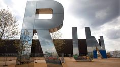 """Run    Three nine-metre-tall mirrored glass and steel letters, each weighing 10 tons, spell the word """"run"""" outside Copper Box, the venue in Olympic Park that will host handball and the modern pentathlon. The artist, Monica Bonivici, was inspired by song titles like Bruce Springsteen's """"Born to Run"""" and The Velvet Underground's """"Run Run Run"""". During the day the letters reflect their surroundings, and at night they glow from the soft light of 300m of energy efficient lights. (David…"""