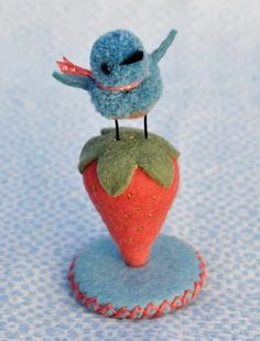 too CUTE~!~ I can hear him chirping... it's a pincushion! I have a feeling this is the inspiration for several birds that will go in this room.