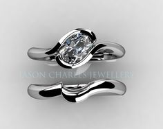http://www.jasoncharlesjewellery.co.uk/wp-content/gallery/engagement-rings/E34%20-%2018ct%20White%20Gold%20Oval%20Diamond%20Crossover%20Engagement%20Ring%20with%20Matching%20Wedding%20Band.jpg