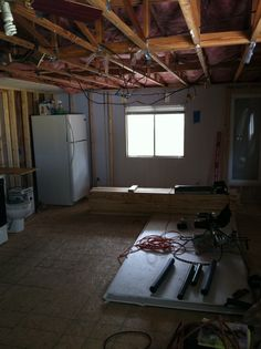 new living room area - ceiling removed - prior to panels and beams installed in ceiling