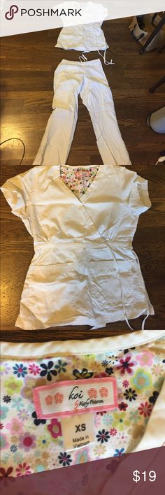 White xs thick soft scrubs brand: peaches/ koi set Top is koi brand and botttom is peaches but they are a set and have the same interior design. Thick scrubs for someone who gets cold easily and much softer than dickies or Cherokee. Minor stain that could probably be washed out on leg. Other